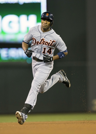 Sep 24, 2013; Minneapolis, MN, USA; Detroit Tigers center fielder Austin Jackson (14) rounds second base after hitting a home run in the fourth inning against the Minnesota Twins at Target Field. Mandatory Credit: Jesse Johnson-USA TODAY Sports