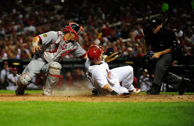 Sep 24, 2013; St. Louis, MO, USA; Washington Nationals catcher Wilson Ramos (40) tags out St. Louis Cardinals catcher Yadier Molina (4) during the fourth inning at Busch Stadium. Mandatory Credit: Jeff Curry-USA TODAY Sports