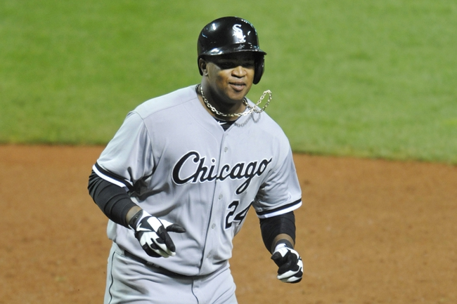 Sep 24, 2013; Cleveland, OH, USA; Chicago White Sox left fielder Dayan Viciedo (24) celebrates his solo home run in the ninth inning against the Cleveland Indians at Progressive Field. Mandatory Credit: David Richard-USA TODAY Sports
