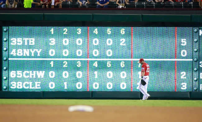 Sep 24, 2013; Arlington, TX, USA; Texas Rangers left fielder Craig Gentry (23) in the outfield during the game against the Houston Astros at Rangers Ballpark in Arlington. Mandatory Credit: Tim Heitman-USA TODAY Sports