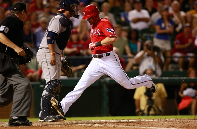 Sep 24, 2013; Arlington, TX, USA; Texas Rangers left fielder Craig Gentry (23) scores a run in the fifth inning of the game against the Houston Astros at Rangers Ballpark in Arlington. Mandatory Credit: Tim Heitman-USA TODAY Sports