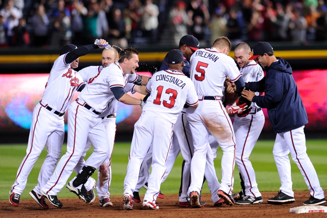 Sep 24, 2013; Atlanta, GA, USA; The Atlanta Braves react after scoring the winning run against the Milwaukee Brewers during the  ninth inning at Turner Field. The Braves defeated the Brewers 3-2. Mandatory Credit: Dale Zanine-USA TODAY Sports