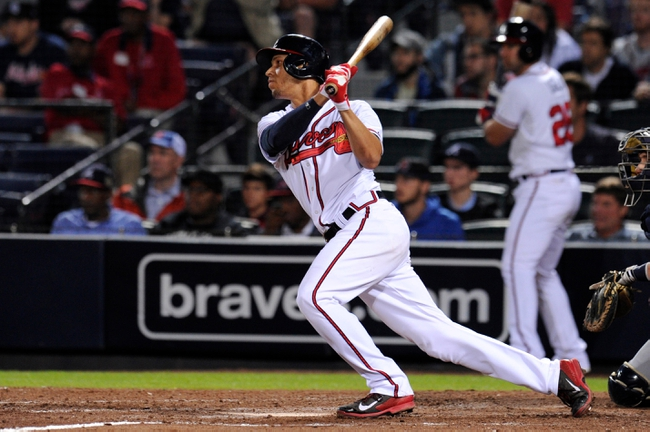 Sep 24, 2013; Atlanta, GA, USA; Atlanta Braves shortstop Andrelton Simmons (19) drives in the game winning run against the Milwaukee Brewers during the ninth inning at Turner Field. The Braves defeated the Brewers 3-2. Mandatory Credit: Dale Zanine-USA TODAY Sports