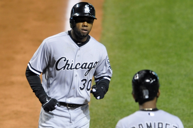 Sep 24, 2013; Cleveland, OH, USA; Chicago White Sox center fielder Alejandro De Aza (30) celebrates his solo home run in the ninth inning against the Cleveland Indians at Progressive Field. Mandatory Credit: David Richard-USA TODAY Sports