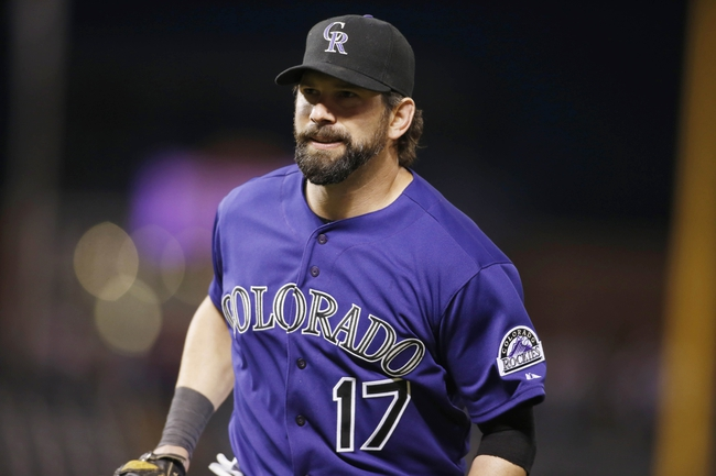 Sep 24, 2013; Denver, CO, USA; Colorado Rockies first baseman Todd Helton (17) during the fourth inning against the Boston Red Sox at Coors Field. Mandatory Credit: Chris Humphreys-USA TODAY Sports