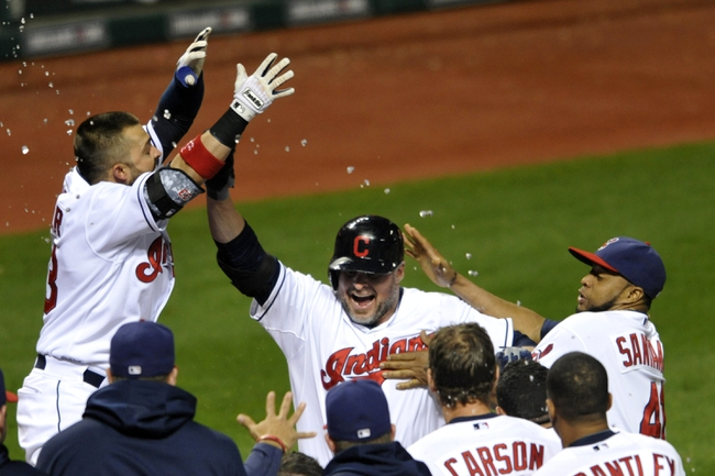 Sep 24, 2013; Cleveland, OH, USA; Cleveland Indians designated hitter Jason Giambi (center) celebrates his game-winning two-run home run in the ninth inning against the Chicago White Sox at Progressive Field. Cleveland won 5-4. Mandatory Credit: David Richard-USA TODAY Sports