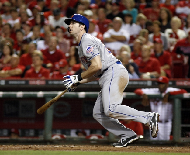 Sep 24, 2013; Cincinnati, OH, USA; New York Mets right fielder Mike Baxter bats during a game against the Cincinnati Reds at Great American Ball Park. Mandatory Credit: David Kohl-USA TODAY Sports