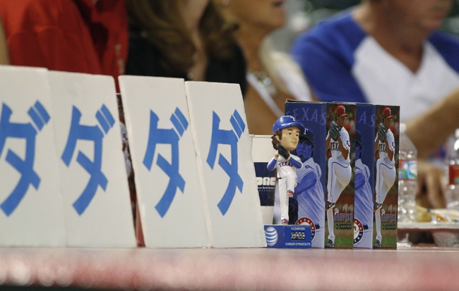 Sep 24, 2013; Arlington, TX, USA; A Texas Rangers starting pitcher Yu Darvish (11) bobble head doll on the dugout during the game against the Houston Astros at Rangers Ballpark in Arlington. The Texas Rangers beat the Houston Astros 3-2. Mandatory Credit: Tim Heitman-USA TODAY Sports