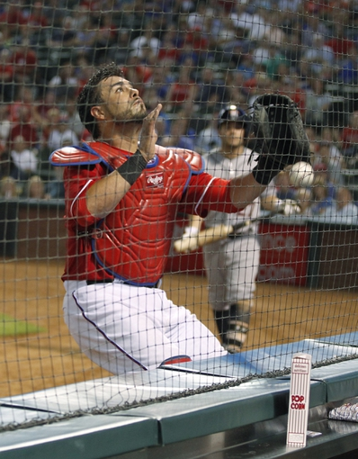 Sep 24, 2013; Arlington, TX, USA; Texas Rangers catcher Geovany Soto (8) cannot catch a foul ball during the seventh inning of the game against the Houston Astros at Rangers Ballpark in Arlington. The Texas Rangers beat the Houston Astros 3-2. Mandatory Credit: Tim Heitman-USA TODAY Sports