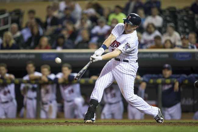Sep 24, 2013; Minneapolis, MN, USA; Minnesota Twins right fielder Chris Parmelee (27) hits a double in the ninth inning against the Detroit Tigers at Target Field. The Tigers won 4-2. Mandatory Credit: Jesse Johnson-USA TODAY Sports