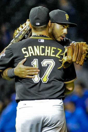 Sep 24, 2013; Chicago, IL, USA;  Pittsburgh Pirates infielder Gabby Sanchez and infielder Pedro Alvarez hug after beating the Chicago Cubs 8-2 at Wrigley Field. Mandatory Credit: Matt Marton-USA TODAY Sports