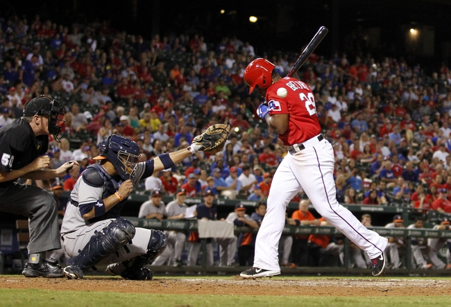 Sep 24, 2013; Arlington, TX, USA; Texas Rangers third baseman Adrian Beltre (29) is hit by a pitch in the eighth inning of the game against the Houston Astros at Rangers Ballpark in Arlington. The Texas Rangers beat the Houston Astros 3-2. Mandatory Credit: Tim Heitman-USA TODAY Sports