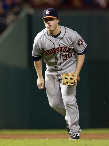 Sep 24, 2013; Arlington, TX, USA; Houston Astros third baseman Matt Dominguez (30) charges home plate in the eighth inning of the game against the Texas Rangers at Rangers Ballpark in Arlington. The Texas Rangers beat the Houston Astros 3-2. Mandatory Credit: Tim Heitman-USA TODAY Sports