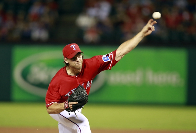 Sep 24, 2013; Arlington, TX, USA; Texas Rangers relief pitcher Neal Cotts (56) throws a pitch in the sixth inning of the game against the Houston Astros at Rangers Ballpark in Arlington. The Texas Rangers beat the Houston Astros 3-2.  Mandatory Credit: Tim Heitman-USA TODAY Sports