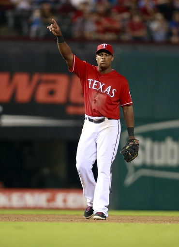 Sep 24, 2013; Arlington, TX, USA; Texas Rangers third baseman Adrian Beltre (29) points to a foul ball in the ninth inning of the game against the Houston Astros at Rangers Ballpark in Arlington. The Texas Rangers beat the Houston Astros 3-2. Mandatory Credit: Tim Heitman-USA TODAY Sports