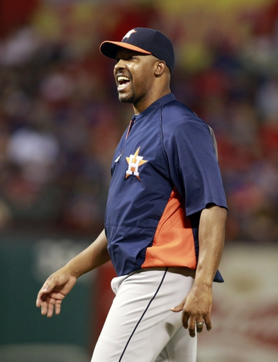 Sep 24, 2013; Arlington, TX, USA; Houston Astros manager Bo Porter (16) calls to the umpire during a pitching change in the seventh inning of the game against the Texas Rangers at Rangers Ballpark in Arlington. The Texas Rangers beat the Houston Astros 3-2. Mandatory Credit: Tim Heitman-USA TODAY Sports
