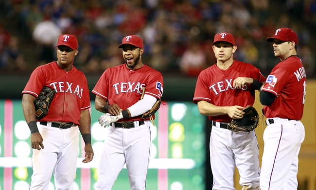 Sep 24, 2013; Arlington, TX, USA; Texas Rangers third baseman Adrian Beltre (29) shortstop Elvis Andrus (1) second baseman Ian Kinsler (5) and first baseman Mitch Moreland (18) watch a pitching change during the game against the Houston Astros at Rangers Ballpark in Arlington. The Texas Rangers beat the Houston Astros 3-2. Mandatory Credit: Tim Heitman-USA TODAY Sports