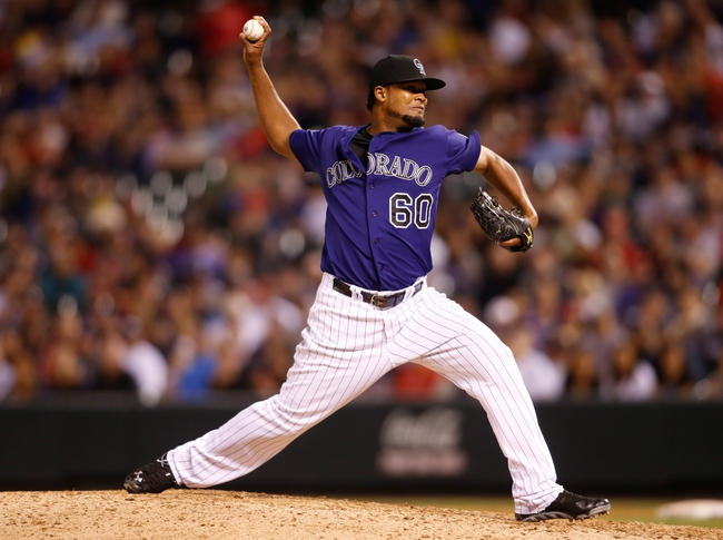 Sep 24, 2013; Denver, CO, USA; Colorado Rockies pitcher Manny Corpas (60) delivers a pitch during the ninth inning against the Boston Red Sox at Coors Field. The Rockies won 8-3.  Mandatory Credit: Chris Humphreys-USA TODAY Sports