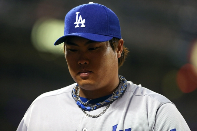Sep 24, 2013; San Francisco, CA, USA; Los Angeles Dodgers starting pitcher Hyun-Jin Ryu (99) returns to the dugout between innings against the San Francisco Giants during the fifth inning at AT&T Park. Mandatory Credit: Kelley L Cox-USA TODAY Sports