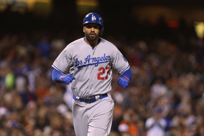 Sep 24, 2013; San Francisco, CA, USA; Los Angeles Dodgers center fielder Matt Kemp (27) scores a solo home run against the San Francisco Giants during the sixth inning at AT&T Park. Mandatory Credit: Kelley L Cox-USA TODAY Sports