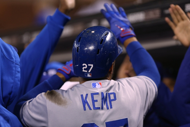 Sep 24, 2013; San Francisco, CA, USA; Los Angeles Dodgers center fielder Matt Kemp (27) high fives teammates in the dugout after hitting a solo home run against the San Francisco Giants during the sixth inning at AT&T Park. Mandatory Credit: Kelley L Cox-USA TODAY Sports