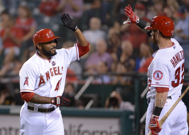 Sep 24, 2013; Anaheim, CA, USA; Los Angeles Angels second baseman Howie Kendrick (47) celebrates with center fielder Josh Hamilton (32) after hitting a solo home run in the first inning against the Oakland Athletics at Angel Stadium of Anaheim. Mandatory Credit: Kirby Lee-USA TODAY Sports