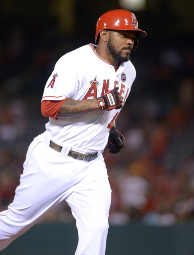 Sep 24, 2013; Anaheim, CA, USA; Los Angeles Angels second baseman Howie Kendrick (47) rounds the bases after hitting a solo home run in the first inning against the Oakland Athletics at Angel Stadium of Anaheim. Mandatory Credit: Kirby Lee-USA TODAY Sports