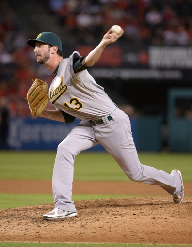 Sep 24, 2013; Anaheim, CA, USA; Oakland Athletics reliever Jerry Barton (13) delivers a pitch against the Los Angeles Angels at Angel Stadium of Anaheim. The Angels defeated the Athletics 3-0. Mandatory Credit: Kirby Lee-USA TODAY Sports
