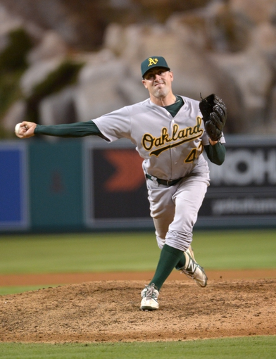 Sep 24, 2013; Anaheim, CA, USA; Oakland Athletics reliever Pat Neshek (47) delivers a pitch against the Los Angeles Angels at Angel Stadium of Anaheim. The Angels defeated the Athletics 3-0. Mandatory Credit: Kirby Lee-USA TODAY Sports