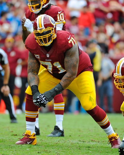 Sep 22, 2013; Landover, MD, USA; Washington Redskins offensive tackle Trent Williams (71) prepares to block against the Detroit Lions during the second half at FedEX Field. The Lions won 27 - 20. Mandatory Credit: Brad Mills-USA TODAY Sports