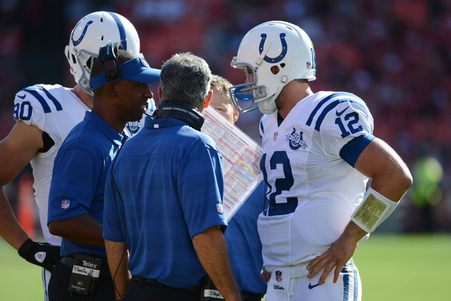 September 22, 2013; San Francisco, CA, USA; Indianapolis Colts offensive coordinator Pep Hamilton (visor) talks to quarterback Andrew Luck (12) during the fourth quarter against the San Francisco 49ers at Candlestick Park. The Colts defeated the 49ers 27-7. Mandatory Credit: Kyle Terada-USA TODAY Sports