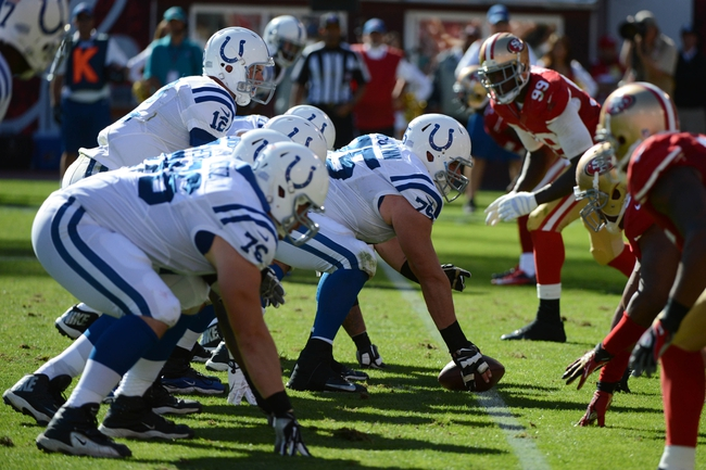 September 22, 2013; San Francisco, CA, USA; Indianapolis Colts quarterback Andrew Luck (12) stands under guard Mike McGlynn (75) at the line of scrimmage during the fourth quarter against the San Francisco 49ers at Candlestick Park. The Colts defeated the 49ers 27-7. Mandatory Credit: Kyle Terada-USA TODAY Sports