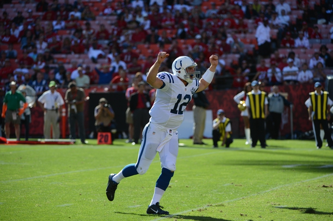 September 22, 2013; San Francisco, CA, USA; Indianapolis Colts quarterback Andrew Luck (12) celebrates after a touchdown during the fourth quarter against the San Francisco 49ers at Candlestick Park. The Colts defeated the 49ers 27-7. Mandatory Credit: Kyle Terada-USA TODAY Sports
