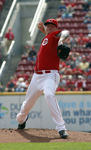 Sep 25, 2013; Cincinnati, OH, USA; Cincinnati Reds starting pitcher Mat Latos throw against the New York Mets in the first inning at Great American Ball Park. Mandatory Credit: David Kohl-USA TODAY Sports