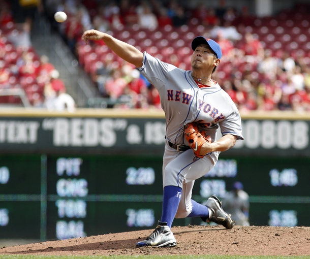 Sep 25, 2013; Cincinnati, OH, USA; New York Mets starting pitcher Daisuke Matsuzaka throws against the Cincinnati Reds in the second inning at Great American Ball Park. Mandatory Credit: David Kohl-USA TODAY Sports