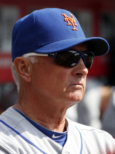 Sep 25, 2013; Cincinnati, OH, USA; New York Mets manager Terry Collins watches from the dugout prior to a game with the Cincinnati Reds at Great American Ball Park. Mandatory Credit: David Kohl-USA TODAY Sports