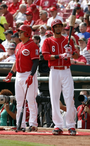 Sep 25, 2013; Cincinnati, OH, USA; Cincinnati Reds center fielder Billy Hamilton (6) and left fielder Shin-Soo Choo (17) prepare on deck at the beginning of a game with the New York Mets at Great American Ball Park. Mandatory Credit: David Kohl-USA TODAY Sports