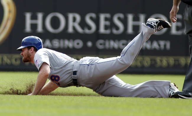 Sep 25, 2013; Cincinnati, OH, USA; New York Mets second baseman Daniel Murphy (28) slides as he steals second base in the first inning at Great American Ball Park. Mandatory Credit: David Kohl-USA TODAY Sports