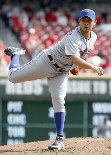 Sep 25, 2013; Cincinnati, OH, USA; New York Mets starting pitcher Daisuke Matsuzaka releases a pitch against the Cincinnati Reds in the second inning at Great American Ball Park. Mandatory Credit: David Kohl-USA TODAY Sports