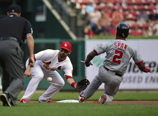 Sep 25, 2013; St. Louis, MO, USA; St. Louis Cardinals second baseman Matt Carpenter (13) receives the throw as Washington Nationals center fielder Denard Span (2) steals second base at Busch Stadium. Mandatory Credit: Scott Rovak-USA TODAY Sports