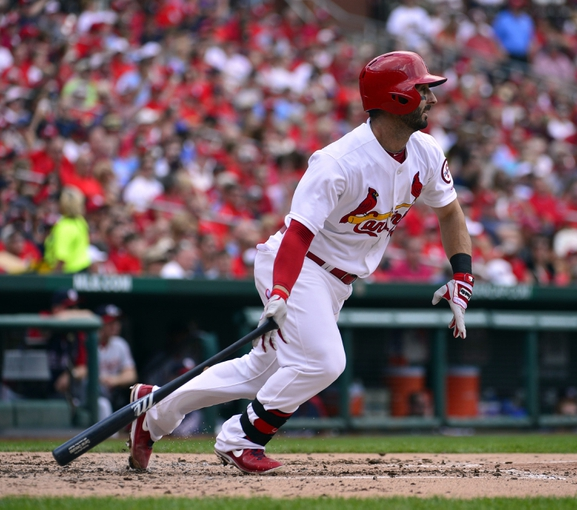 Sep 25, 2013; St. Louis, MO, USA; St. Louis Cardinals shortstop Daniel Descalso (33) hits a double against the Washington Nationals at Busch Stadium. Mandatory Credit: Scott Rovak-USA TODAY Sports