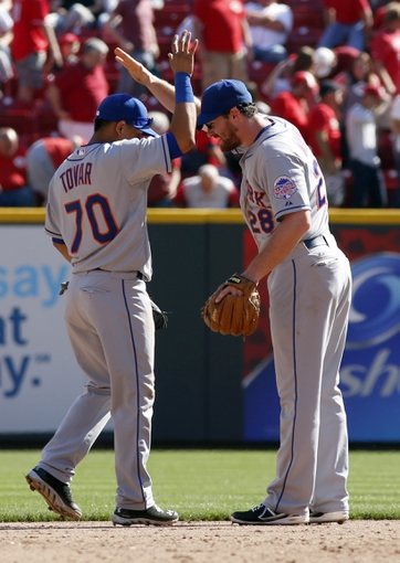 Sep 25, 2013; Cincinnati, OH, USA; New York Mets shortstop Wilfredo Tovar (70) and second baseman Daniel Murphy (28) congratulated each other after the Mets beat the Cincinnati Reds 1-0 at Great American Ball Park. Mandatory Credit: David Kohl-USA TODAY Sports