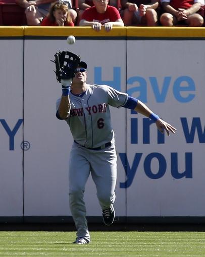 Sep 25, 2013; Cincinnati, OH, USA; New York Mets right fielder Matt den Dekker fields a fly ball during a game against the Cincinnati Reds at Great American Ball Park. The Mets won 1-0. Mandatory Credit: David Kohl-USA TODAY Sports