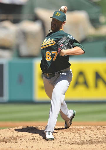 September 25, 2013; Anaheim, CA, USA; Oakland Athletics starting pitcher Dan Straily (67) pitches during the second inning against the Los Angeles Angels at Angel Stadium of Anaheim. Mandatory Credit: Gary A. Vasquez-USA TODAY Sports