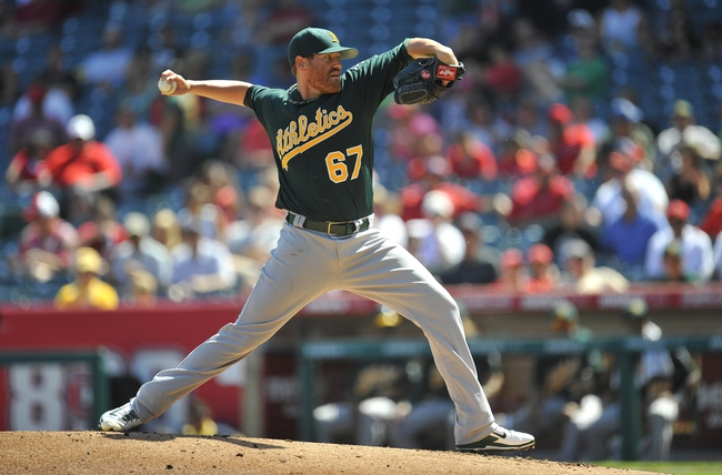 September 25, 2013; Anaheim, CA, USA; Oakland Athletics starting pitcher Dan Straily (67) pitches in the first inning against the Los Angeles Angels at Angel Stadium of Anaheim. Mandatory Credit: Gary A. Vasquez-USA TODAY Sports