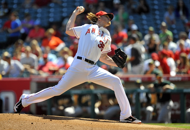 September 25, 2013; Anaheim, CA, USA; Los Angeles Angels starting pitcher Jered Weaver (36) pitches during the first inning against the Oakland Athletics at Angel Stadium of Anaheim. Mandatory Credit: Gary A. Vasquez-USA TODAY Sports