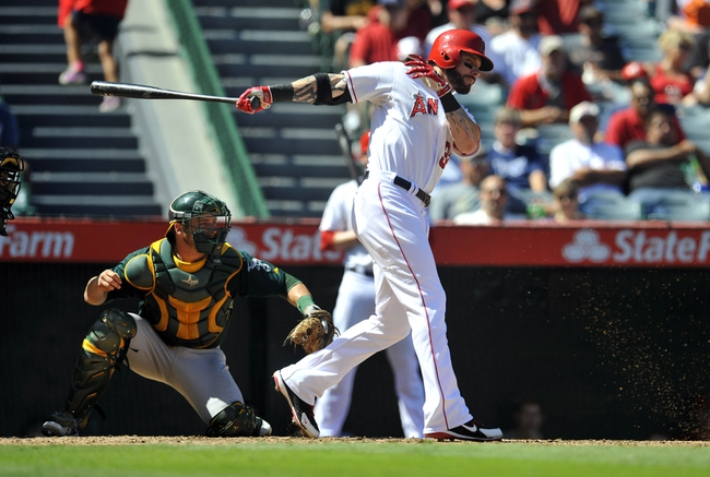 September 25, 2013; Anaheim, CA, USA; Los Angeles Angels right fielder Josh Hamilton (32) hits an RBI single during the fourth inning against the Oakland Athletics at Angel Stadium of Anaheim. Mandatory Credit: Gary A. Vasquez-USA TODAY Sports