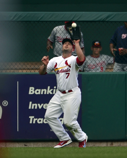 Sep 25, 2013; St. Louis, MO, USA; St. Louis Cardinals left fielder Matt Holliday (7) makes a catch against the Washington Nationals at Busch Stadium. The Cardinals defeated the Nationals 4-1. Mandatory Credit: Scott Rovak-USA TODAY Sports