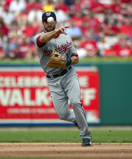 Sep 25, 2013; St. Louis, MO, USA; Washington Nationals second baseman Stephen Lombardozzi (1) throws out a St. Louis Cardinals base runner during the fifth inning at Busch Stadium. The Cardinals defeated the Nationals 4-1. Mandatory Credit: Scott Rovak-USA TODAY Sports