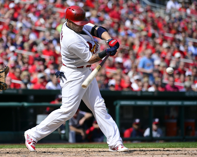 Sep 25, 2013; St. Louis, MO, USA; St. Louis Cardinals catcher Yadier Molina (4) hits a 2 run single against the Washington Nationals during the fourth inning at Busch Stadium. The Cardinals defeated the Nationals 4-1. Mandatory Credit: Scott Rovak-USA TODAY Sports